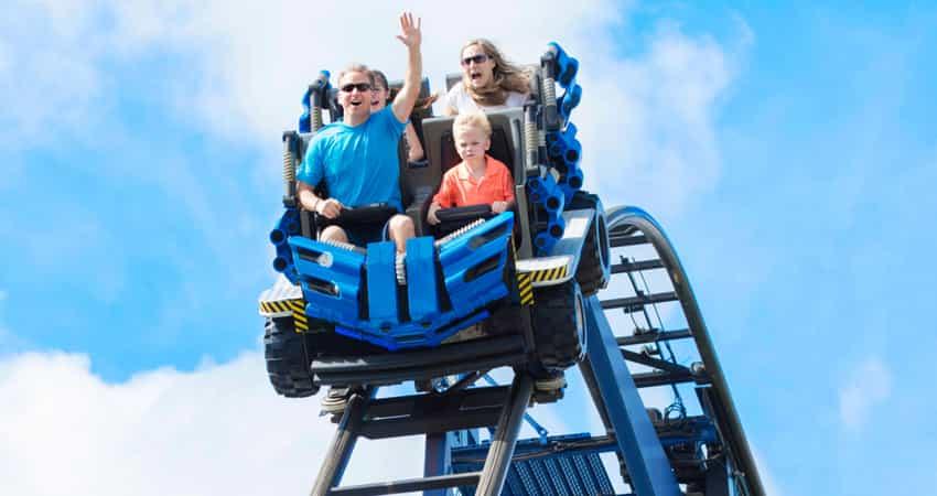 A family riding a roller coaster at Cedar Point