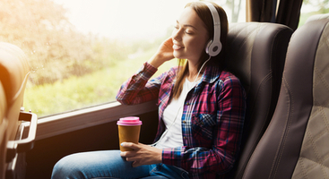Woman listening to headphones on bus